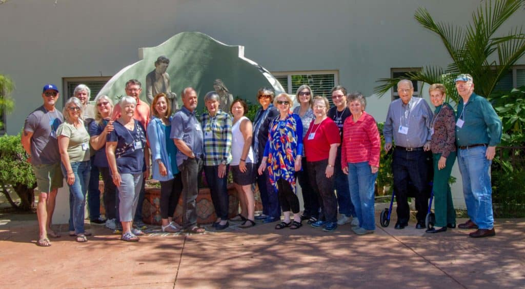 Photo of 19 members of the First Pres community outside of the waterfall in the Serra Retreat Center Courtyard