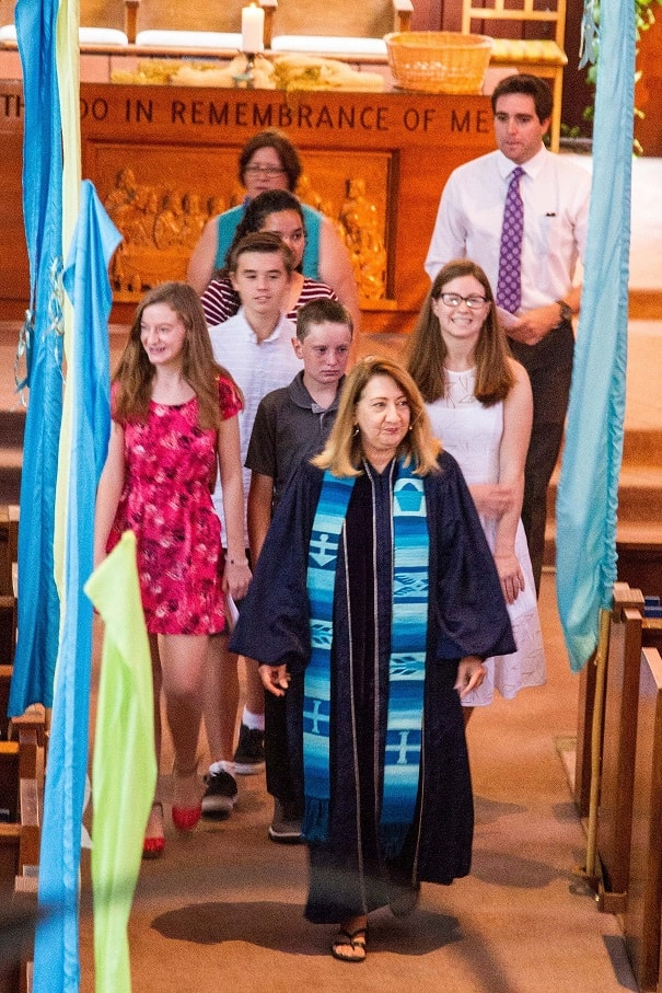 Confirmands process out after service with smiles